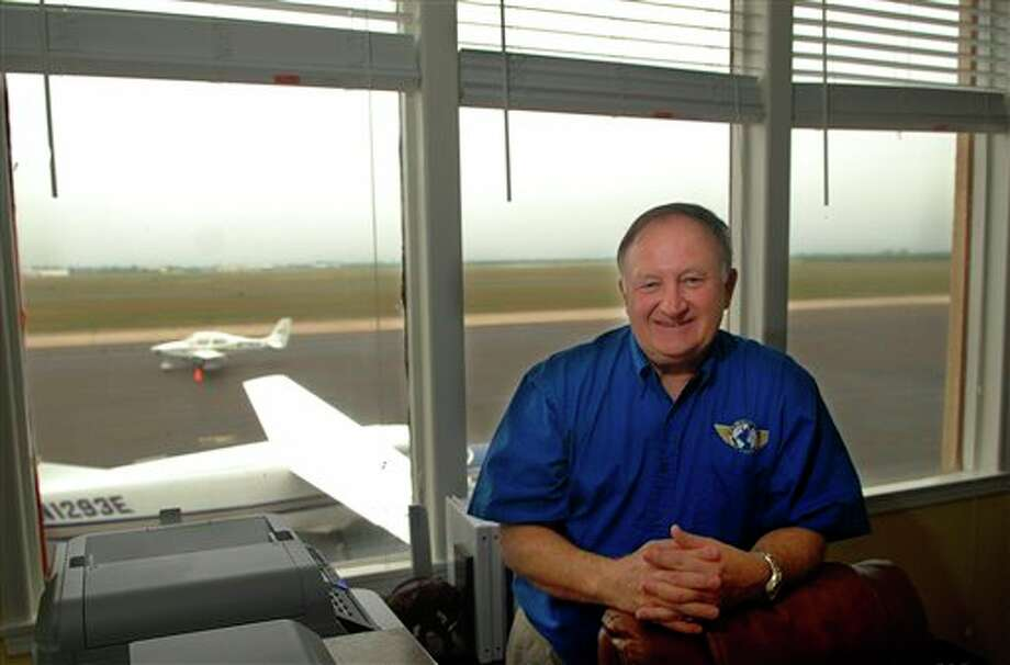 FILE - In a Wednesday, March 29, 2011 file photo, Pan American Airways founder and President, Robert L. Hedrick, sits in his office in the restored Pan Am Airways building at the Brownsville, South Padre Island International Airport. Hedrick is set to be sentenced on federal child pornography charges Wednesday, Dec. 19, 2012 in South Texas. Hedrick was convicted May 21 of three federal counts. The 61-year-old founder of Pan American Airways was accused by prosecutors of having explicit chats with undercover officers posing as young teenage girls. (AP Photo/The Brownsville Herald, Brad Doherty) Photo: Brad Doherty / BROWNSVILLE HERALD