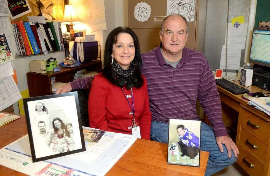 Ron and Rulene Berry, teachers at Midland High, sit at Rulene's desk in her classroom with pictures of their daughter, Rayna Willis, who is currently fighting cancer. James Durbin/Reporter-Telegram Photo: JAMES DURBIN