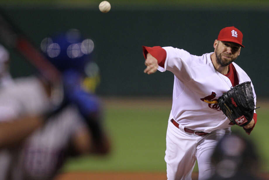 St. Louis Cardinals starting pitcher Chris Carpenter throws during the first inning of Game 7 of baseball's World Series against the Texas Rangers Friday, Oct. 28, 2011, in St. Louis. (AP Photo/Ezra Shaw, Pool) Photo: Ezra Shaw / Getty Images, Pool