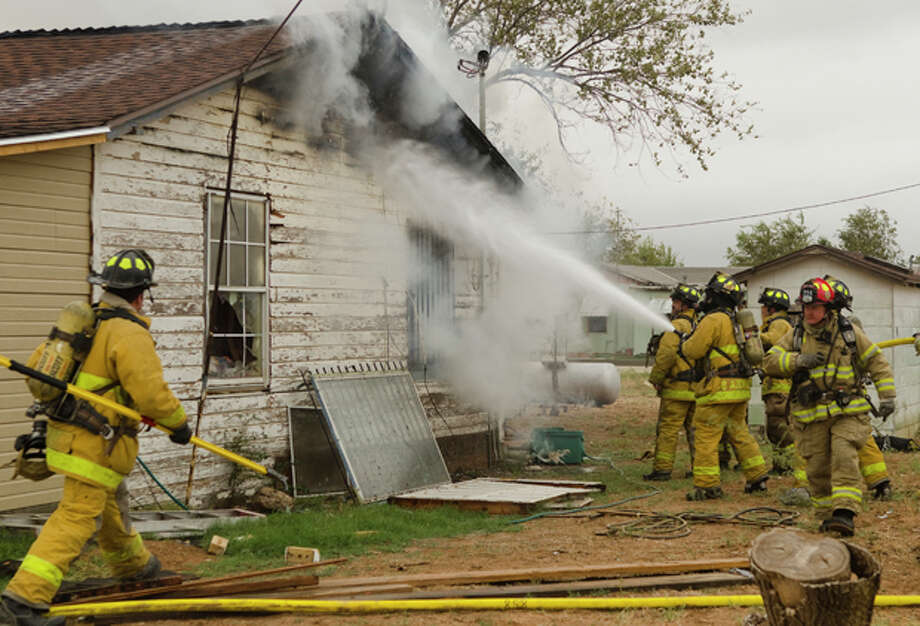 Midland firefighters battle a blaze Thursday afternoon that destroyed a home at 710 S. Fairgrounds. Photo by Tim Fischer/Midland Reporter-Telegram Photo: Tim Fischer