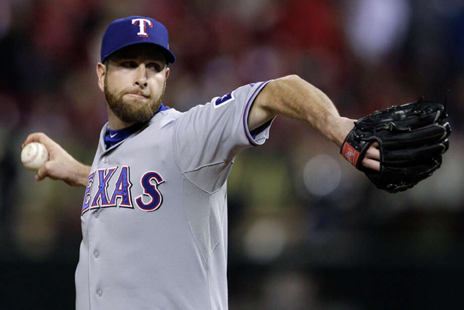 Texas Rangers relief pitcher Scott Feldman throws during the fifth inning of Game 7 of baseball's World Series against the St. Louis Cardinals Friday, Oct. 28, 2011, in St. Louis. (AP Photo/Matt Slocum) Photo: Matt Slocum / AP