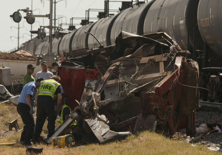 The driver of an 18-wheeler was killed Monday morning when his rig was struck by a train at the Fairgrounds Road crossing. Tim Fischer\Reporter-Telegram Photo: Tim Fischer