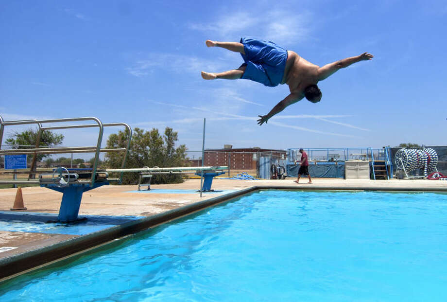 Rene Willingham does a flip off the diving board Saturday at Doug Russell Pool. James Durbin/Reporter-Telegram Photo: JAMES DURBIN