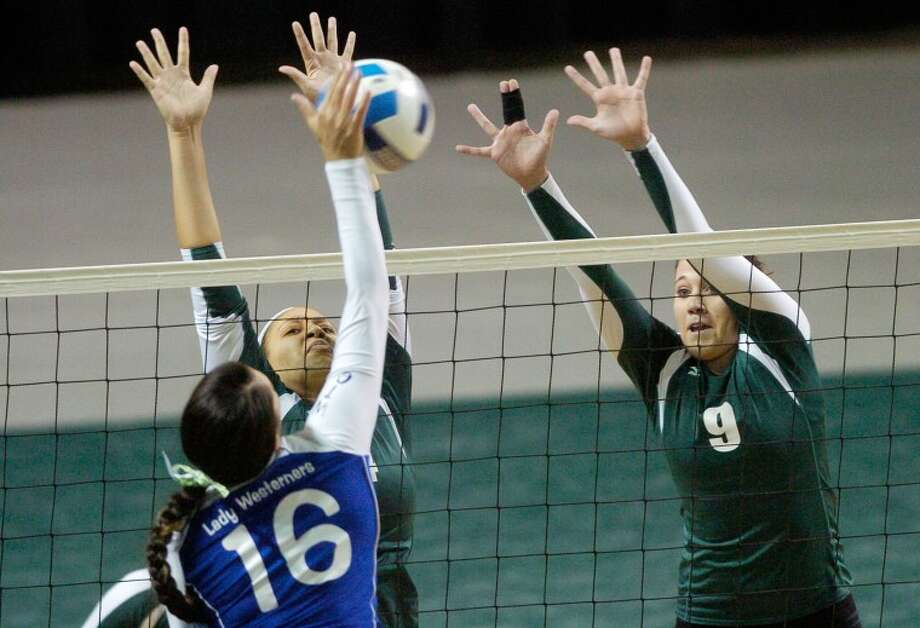 Midland College's Victoria Smith (14), left, and Sarah Sawyer (9) block a ball spiked by Western Texas College's Aubrey Muaina (16) Saturday during their game at Chaparral Center. Cindeka Nealy/Reporter-Telegram Photo: Cindeka Nealy