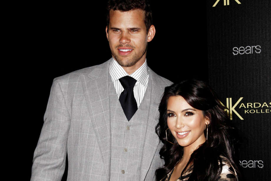 FILE - In this Aug. 17, 2011 file photo, reality TV personality Kim Kardashian, right, and her fiance, NBA basketball player Kris Humphries, arrive at the Kardashian Kollection launch party in Los Angeles. Kardashian is expected to file for divorce in Los Angeles on Monday, Oct. 31, 2011, according to a report confirmed by the producers of her reality show. Kardashian and Humphries were married on Aug. 20. (AP Photo/Matt Sayles, file) Photo: Matt Sayles / AP2011