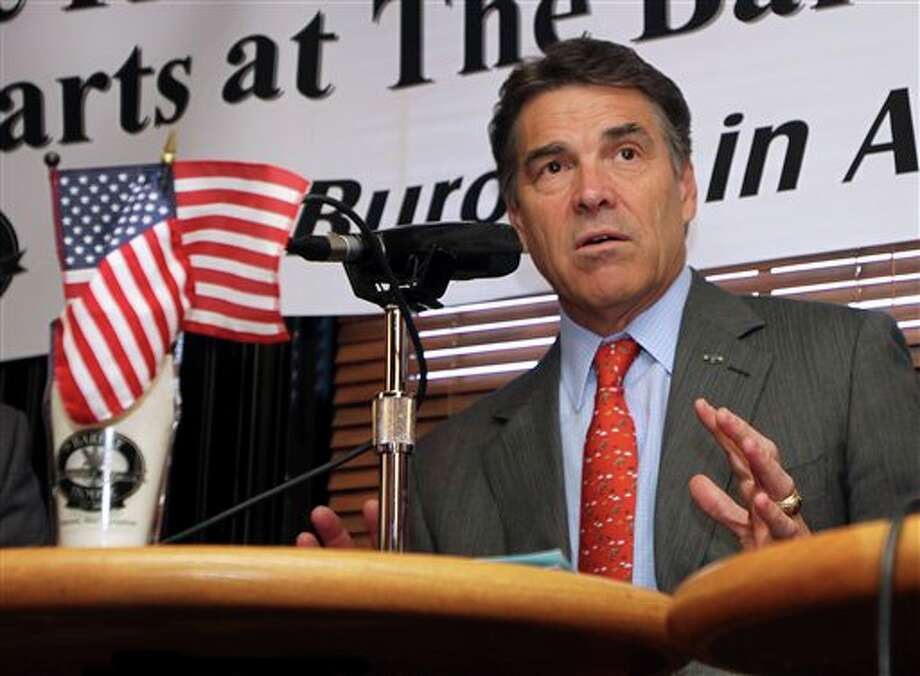 Republican presidential candidate, Texas Gov. Rick Perry tapes a radio show, Friday, Oct. 28, 2011, in Concord, N.H. (AP Photo/Jim Cole) Photo: Jim Cole / AP