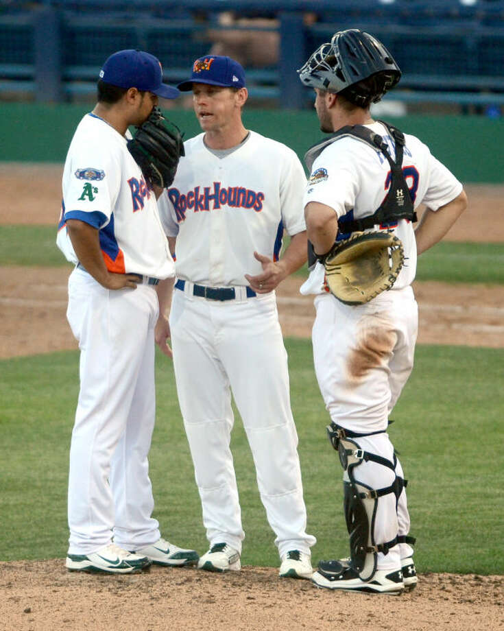 Rockhounds' pitcher Arnold Leon and catcher David Freitas talk with manager Aaron Nieckula (at center) on the mound during a game against the Tulsa Drillers last season at Citibank Ballpark. James Durbin/Reporter-Telegram Photo: JAMES DURBIN