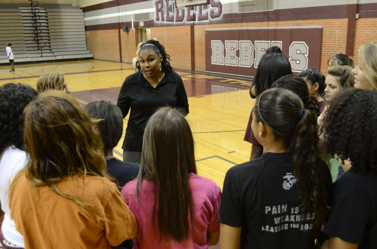 Monica Ramirez, new Lee head girls basketball coach, talks with players Thursday following a press conference to introduce her to Lee fans and supporters. Tim Fischer\Reporter-Telegram
