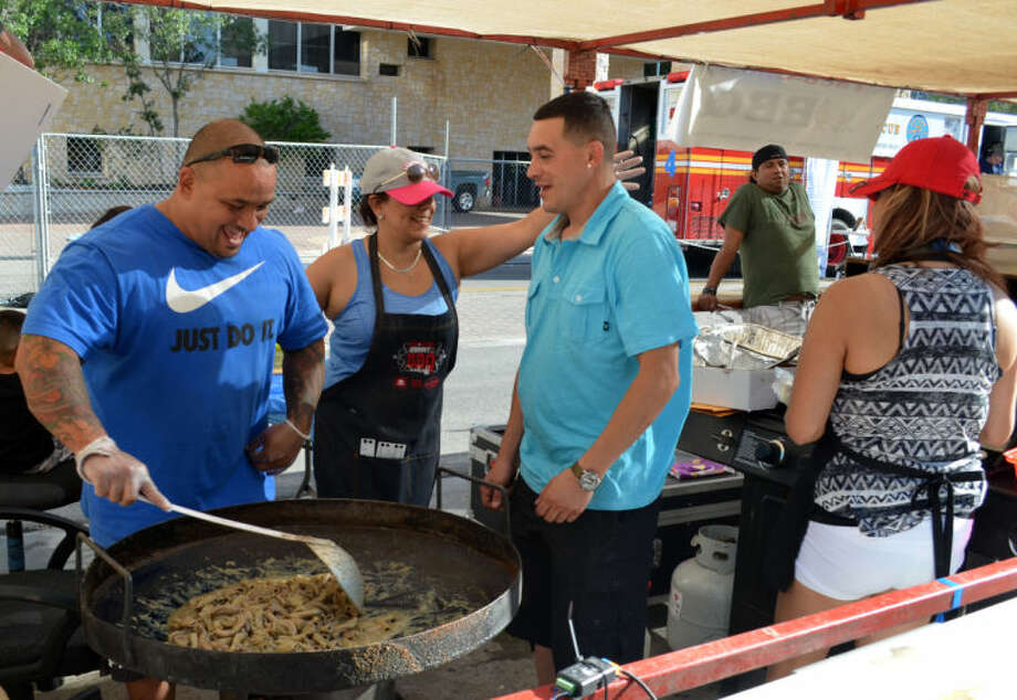 Mike Carbenas grill Tripas at DS Tacos during the 26th annual Mex-Tex Family Fiesta in downtown Midland Friday evening. Photo: James Cannon/MRT