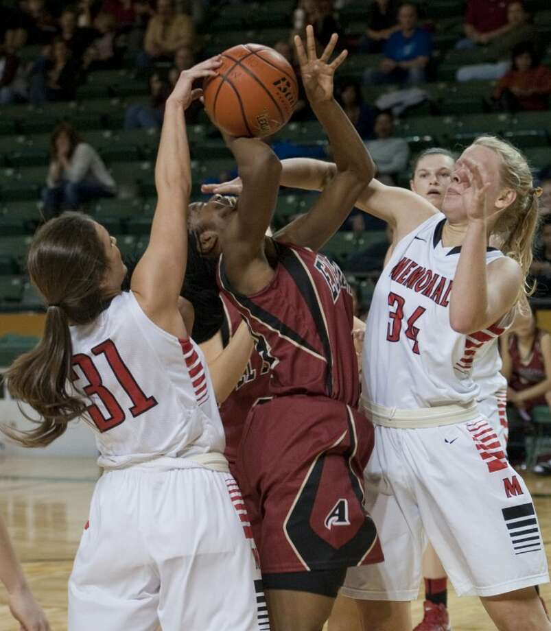 El Paso El Dorado's Adeola Akomolafe gets mauled by Houston Memorial's Olivia Podaras, 31 and Madison Rushing, 34, as she attempts a shot Saturday in the championship game of the Byron Johnston Holiday Classic at the Chaparral Center. Tim Fischer\Reporter-Telegram Photo: Tim Fischer