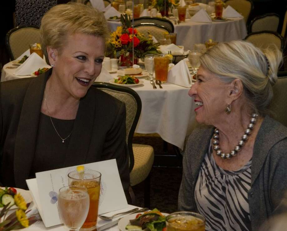 Liz Roberson, left talks with Barbara Craig at the 2011 National Philantropy Day luncheon. Roberson was honored as the outstanding volunteer fundraiser for her various help to area non-profits throughout the Permian Basin. Photo by Tim Fischer/Midland Reporter-Telegram Photo: Tim Fischer