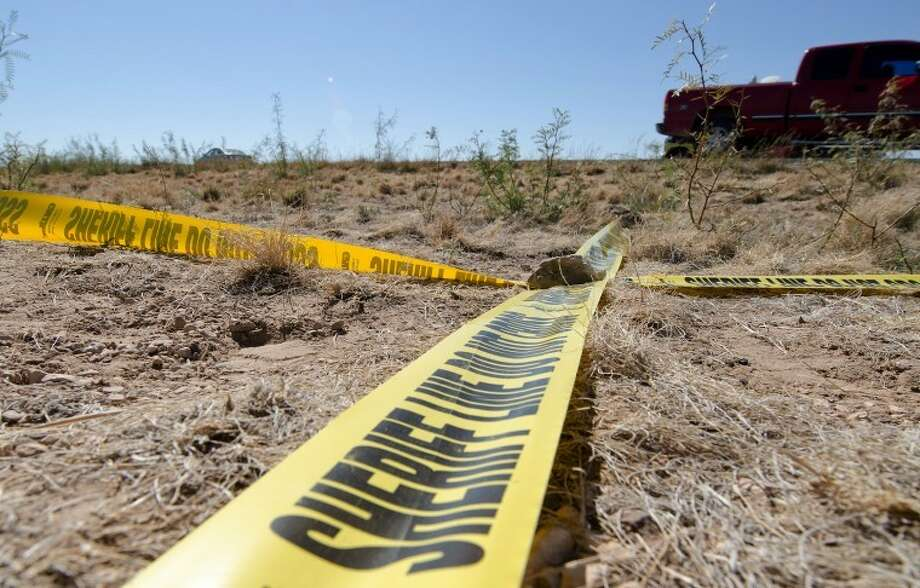 "Ector County Sheriff's Office tape ""X Marks"" the spot where the body of a white male between his 30s or 40s was found Tuesday along Farm-to-Market Road 554, south of Gardendale. Cindeka Nealy/Reporter-Telegram Photo: Cindeka Nealy"