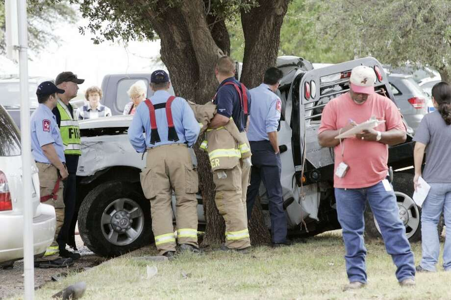 (File Photo) Midland Fire Department personnel await the arrival of the Justice of the Peace after the driver of a Dodge Ram 2500 lost control of his vehicle and hit a tree, Friday at 2405 S. Loop 250. Cindeka Nealy/Reporter-Telegram Photo: Cindeka Nealy