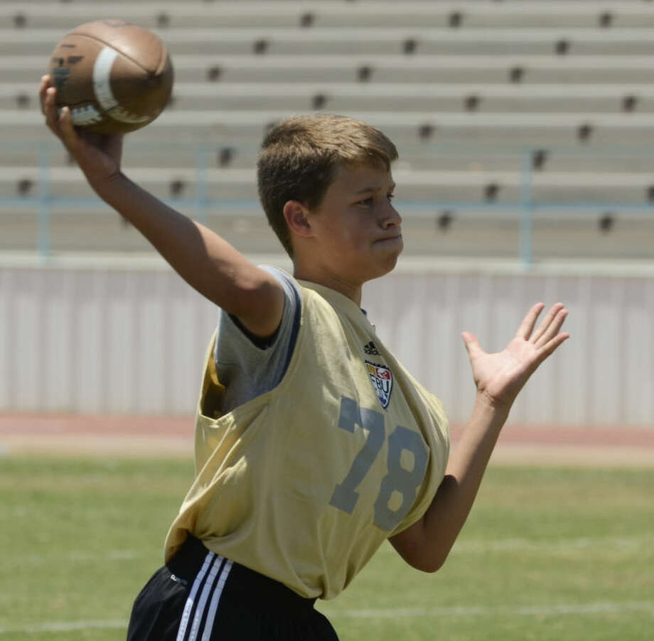 Jake Somers, from Greenwood, works out with other quarterbacks Saturday at the FBU football clinic in Greenwood. Tim Fischer\Reporter-Telegram Photo: Tim Fischer