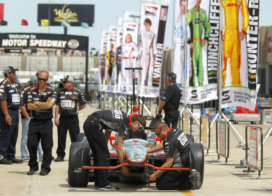 Team members work on the nose of the #4 National Guard sponsored Chevrolet driven by Oriol Servia before the start of IZOD IndyCar qualifying Friday, June 7 at Texas Motor Speedway. James Durbin/Reporter-Telegram Photo: JAMES DURBIN