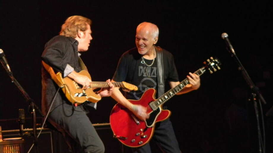 Peter Frampton, right, performs Saturday at the Wagner Noel Performing Arts Center. Pictured with Frampton is John Jorgenson. Photo: Nancy Adamson/Reporter-Telegram