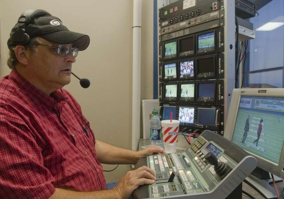 James Hawk runs the board to control the big screen Oct. 28 at Grande Communications Stadium. Photo by Tim Fischer/Midland Reporter-Telegram Photo: Tim Fischer