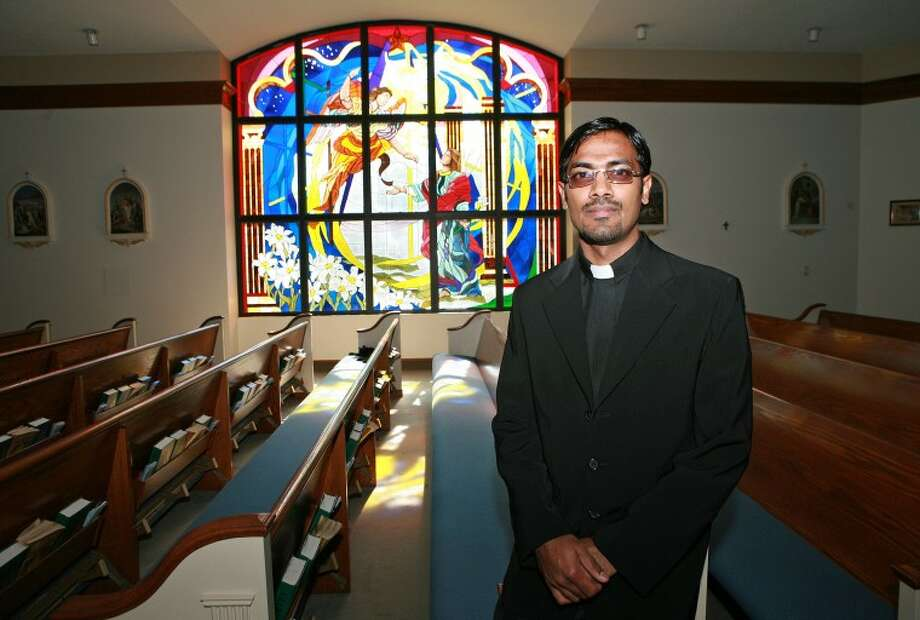 The Rev. Joseph Prem is a new priest at St. Stephen's Catholic Church. Cindeka Nealy/Reporter-Telegram Photo: Cindeka Nealy