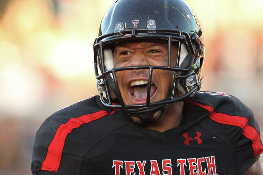 Texas Tech's Cornelius Douglas reacts as he breaks free for a touchdown against Kansas State during an NCAA college football game in Lubbock, Texas, on Saturday, Oct. 15, 2011. (AP Photo/The Lubbock Avalanche-Journal, Stephen Spillman) Photo: Stephen Spillman / Lubbock Avalanche-Journal