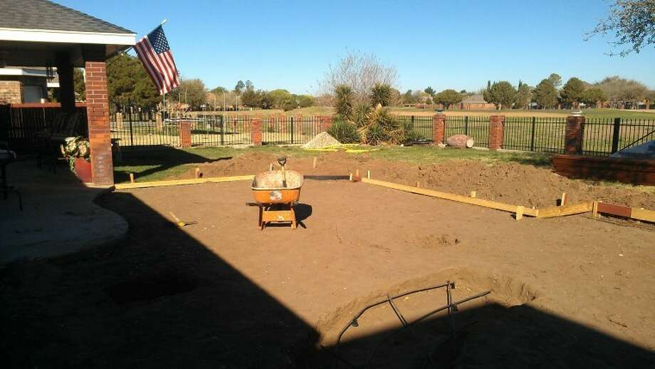 This yard, located on Rustic Trail, is being redesigned by American Home Improvement. Grass has been removed and will be replaced with a cedar patio cover, outdoor kitchen, fire pit, patio and some stone walls. Photo: American Home Improvement