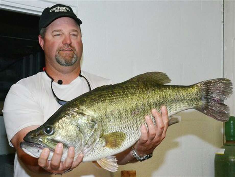Ronald Kyle Johnson, of Abilene, holds the largemouth bass he caught at O.H. Ivie Reservoir. The fish was 13.36 pounds and 27.5 inches long and 20 inches in girth. Photo: Associated Press Via Texas Parks And Wildlife Department / Texas Parks and Wildlife Department