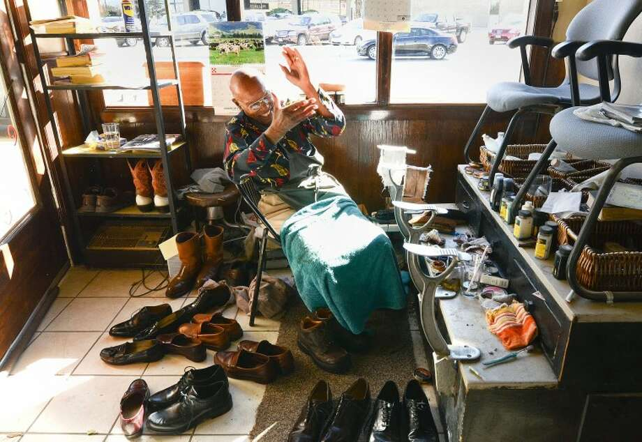 Lonnie Wells is a World War II veteran who has polished shoes at Lone Star Barbershop since 1990. Cindeka Nealy/Reporter-Telegram Photo: Cindeka Nealy
