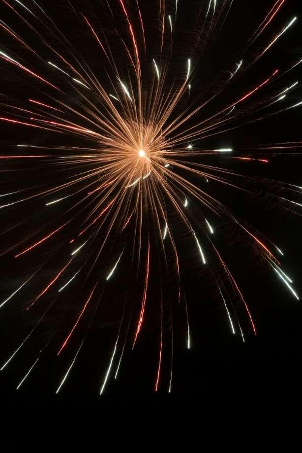 (2010 File Photo) Fireworks explode illuminating the sky Saturday night following the Midland RockHounds and Arkansas Travelers baseball game. Cindeka Nealy/ Reporter-Telegram Photo: Cindeka Nealy