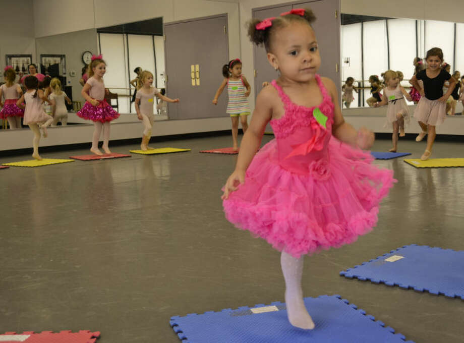 McKinley Evans and others practice turning on one foot at Midland Festival Ballet Princess camp. Tim Fischer\Reporter-Telegram Photo: Tim Fischer