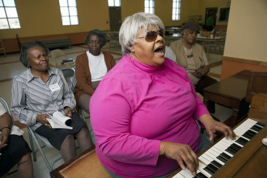 "Norma Lewis-Hill sings ""Just A Little Talk with Jesus"" during a ""Golden Guild Singers"" rehearsal at the Southeast Senior Center. Lewis-Hill retired as a MISD music teacher shortly before losing her eyesight in 1994 as a result of diabetes. Cindeka Nealy/Reporter-Telegram Photo: Cindeka Nealy"