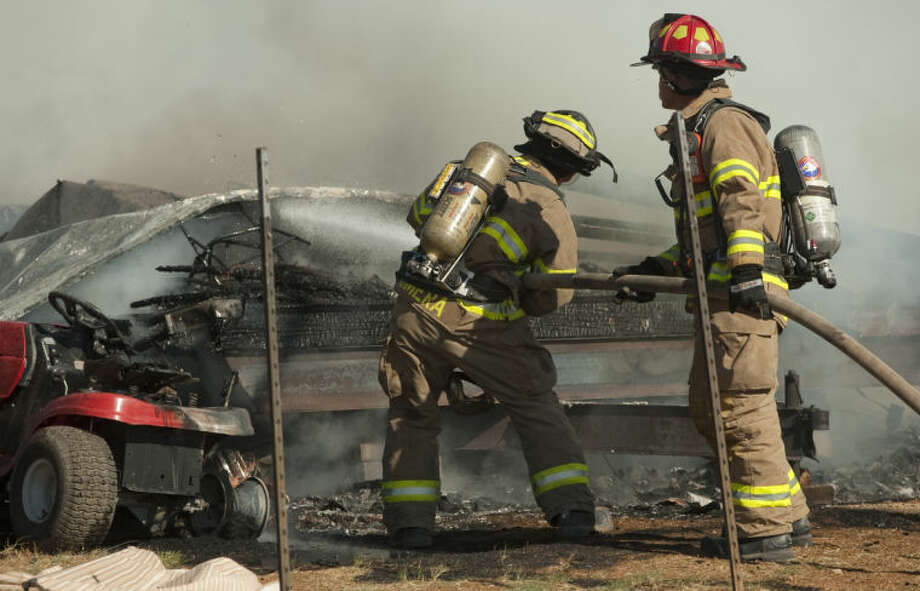 Midland and Northeast fire units try to contain a mobile home fire Tuesday morning on E. County Road 63. No one was injured in the blaze that destroyed the home. Tim Fischer\Reporter-Telegram Photo: Tim Fischer