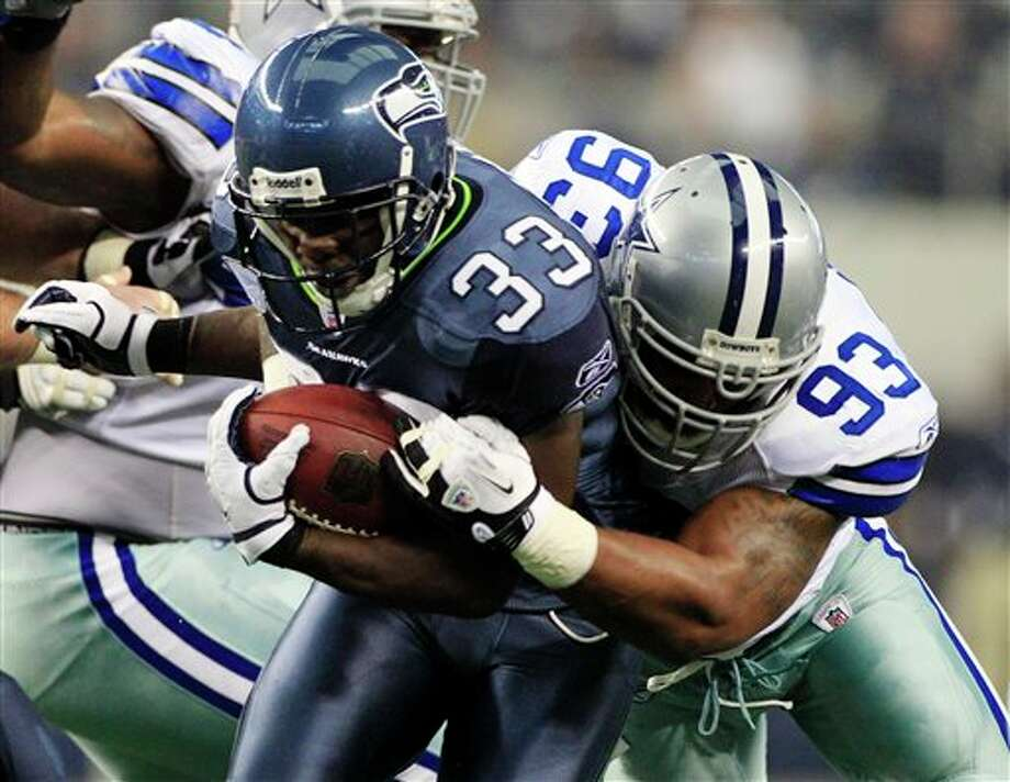 Seattle Seahawks' Leon Washington (33) is taken down by Dallas Cowboys' Anthony Spencer during the first half of an NFL football game on Sunday, Nov. 6, 2011, in Arlington, Texas. (AP Photo/Tony Gutierrez) Photo: Tony Gutierrez / AP