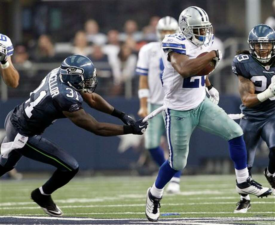 Dallas Cowboys' DeMarco Murray (29) takes the ball downfield as Seattle Seahawks' Kam Chancellor (31) defends during the first half of an NFL football game on Sunday, Nov. 6, 2011, in Arlington, Texas. (AP Photo/Jim Cowsert) Photo: Jim Cowsert / Jim Cowsert