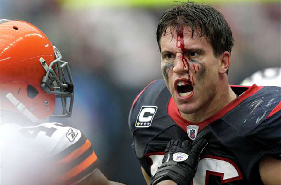 Houston Texans inside linebacker Brian Cushing, right, reacts after being hit by Cleveland Browns' Shawn Lauvao, as T.J. Ward, left, holds him off, in the second quarter of an NFL football game on Sunday, Nov. 6, 2011, in Houston. Lauvao was called for a personal foul on the play. (AP Photo/David J. Phillip) Photo: David J. Phillip / AP