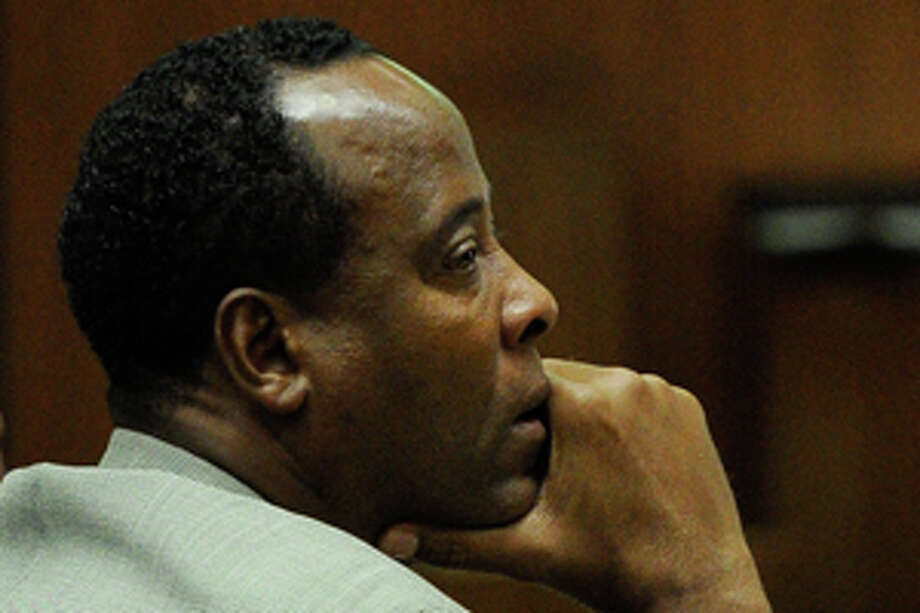 FILE - In a Thursday, Nov. 3, 2011 file photo, Dr. Conrad Murray listens as defense attorney Ed Chernoff, not pictured, gives the defense's closing arguments during the final stage of Conrad Murray's defense in his involuntary manslaughter trial in the death of singer Michael Jackson at the Los Angeles Superior Court in Los Angeles, Calif. The juryis set to resume deliberations Monday, Nov. 7, 2011 after spending their first day in discussions Friday without reaching a verdict. (AP Photo/Kevork Djansezian, Pool, File) Photo: Kevork Djansezian / 2011 Getty Images