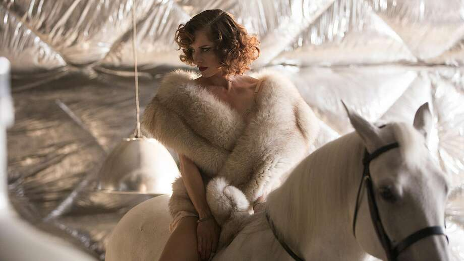 """Above: Sienna Guillory is Jane in """"High-Rise,"""" an imaginative presentation of the old story of tension between social classes. Left: Tom Hiddleston is the doctor in the strangely con struc ted, metaphor- invok ing , patently inequitable  verti  cal community. Photo: Aidan Monaghan/Magnolia Pictures, TNS"""