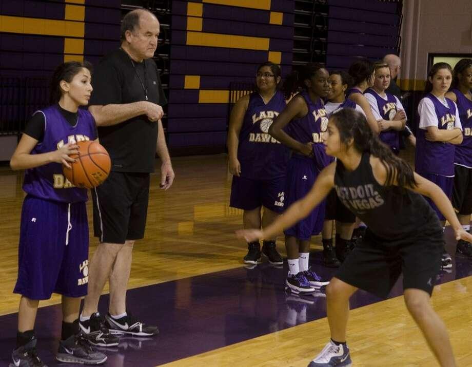 Midland High girls basketball coach Ron Berry works with his team Wednesday afternoon. Photo by Tim Fischer/Midland Reporter-Telegram Photo: Tim Fischer