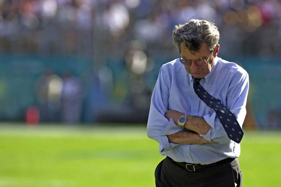 FILE - In this Jan. 1, 2003 file photo, Joe Paterno, Oenn State head football coach, walks along the sideline during the Capital One Bowl against Auburn, in Orlando. Auburn won, 13-9. Penn State administrators on Tuesday, Nov. 8, 2011 canceled Paterno's weekly news conference, in which he was expected to field questions about a sex-abuse scandal involving former defensive coach Jerry Sandusky. (AP Photo/Phelan Ebenhack, File) Photo: PHELAN EBENHACK / AP2003