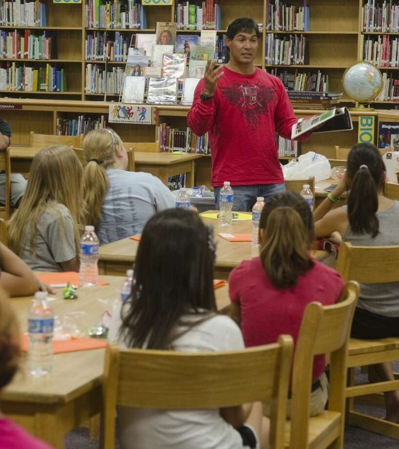 Jay Marquez, director of ministry with Teen FLOW youth ministries, talks to girls in the Face the Race program at Goddard Junior High Monday afternoon. Photo by Tim Fischer/Midland Reporter-Telegram Photo: Tim Fischer