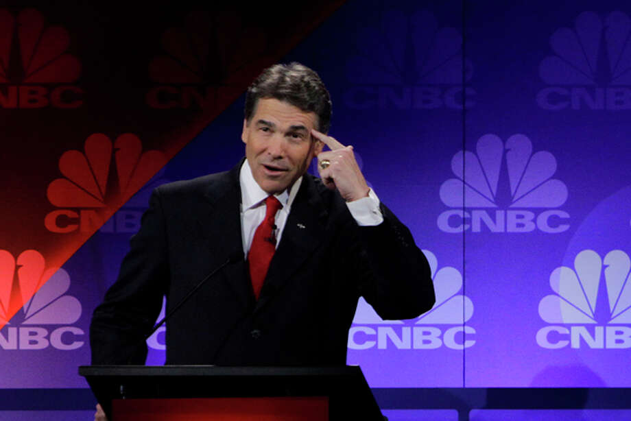 Republican presidential candidate Texas Gov. Rick Perry points his head as he speaks during a Republican Presidential Debate at Oakland University in Auburn Hills, Mich., Wednesday, Nov. 9, 2011.(AP Photo/Paul Sancya) Photo: Paul Sancya / AP