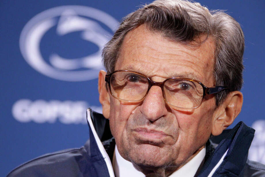 Penn State head coach Joe Paterno talks with reporters after recording his 409th career win 10-7 over Illinois in an NCAA college football game in State College, Pa., Saturday, Oct. 29, 2011. (AP Photo/Gene J. Puskar) Photo: Gene J. Puskar / AP