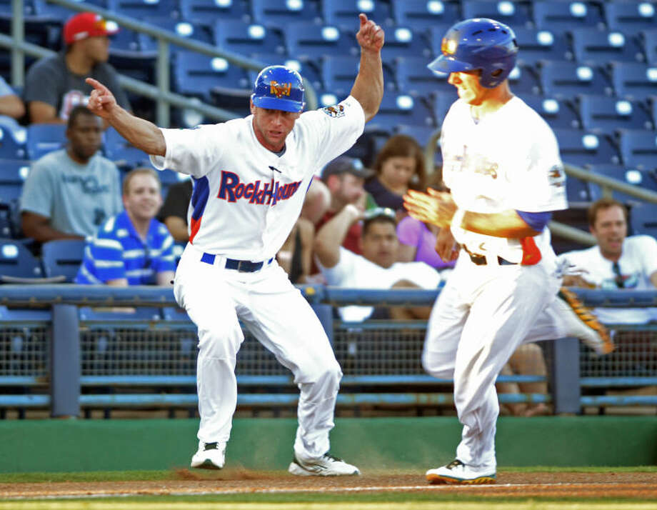 RockHounds manager Aaron Nieckula tells Dusty Coleman to run home during the game against San Antonio Wednesday at Citibank Ballpark. James Durbin/Reporter-Telegram Photo: JAMES DURBIN