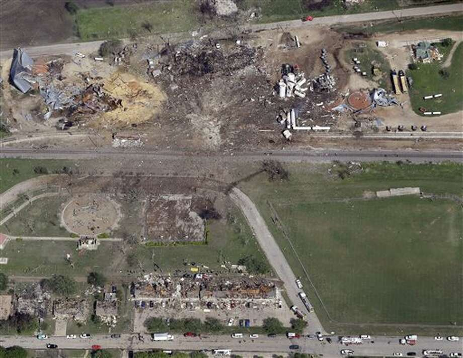 "This April 18, 2013 aerial photo shows a destroyed fertilizer plant, top, following an explosion in West, Texas. The Federal Emergency Management Agency is refusing to provide money to help rebuild West, the small Texas town where a deadly fertilizer plant explosion leveled numerous homes and a school, and killed 15 people. According to a letter obtained by The Associated Press, FEMA said it reviewed the state's appeal to help West but decided that the explosion ""is not of the severity and magnitude that warrants a major disaster declaration."" FEMA has, however, provided emergency funds to individual residents. (AP Photo/Tony Gutierrez) Photo: Tony Gutierrez / AP"