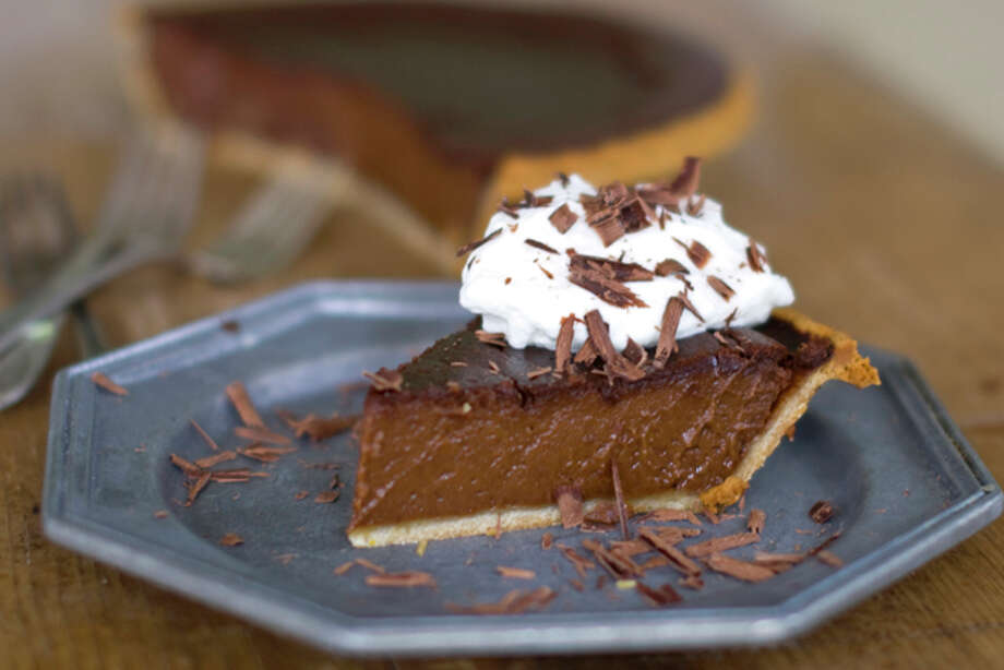 This Oct. 17, 2011 photo shows midnight pumpkin pie in Concord, N.H. This pumpkin pie recipe combines chocolate and pumpkin into a perfectly rich treat that honors tradition while satisfying the need for chocolate. (AP Photo/Matthew Mead) Photo: Matthew Mead / FR170582 AP