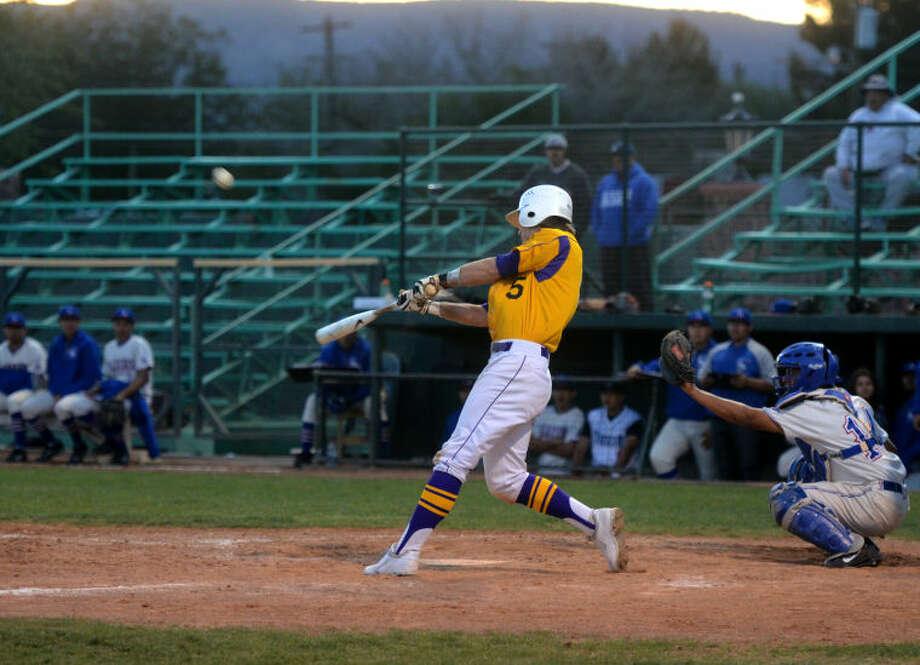 Midland's Brent Stewart hits against El Paso in the bi-district playoff round Friday at Kokernot Field in Alpine. James Durbin/Reporter-Telegram Photo: JAMES DURBIN