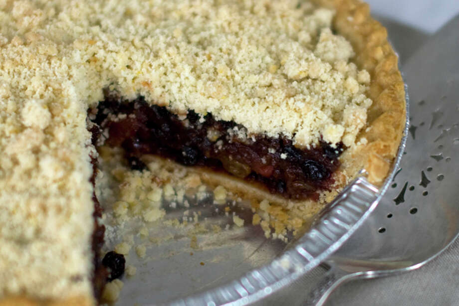 This Oct. 13, 2011 photo shows citrus mincemeat crumb pie in Concord, N.H. This thick mincemeat crumb-topped pie is jammed with dried fruit, spices and citrus zest. (AP Photo/Matthew Mead) Photo: Matthew Mead / FR170582 AP