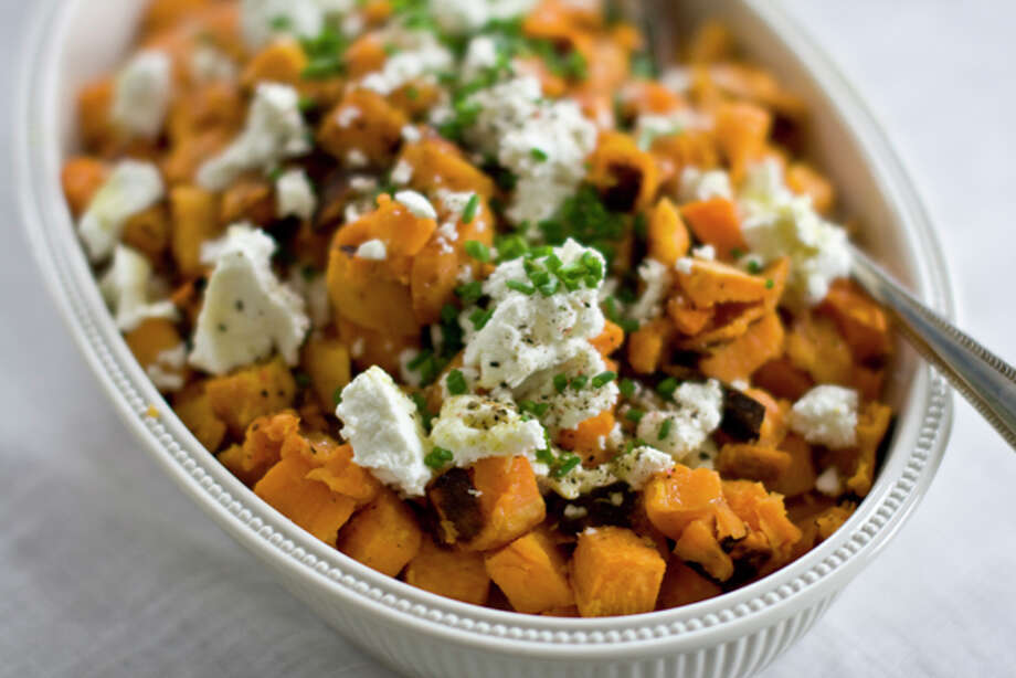 This Oct. 13, 2011 photo shows sweet potatoes with lemon-lime vinaigrette in Concord, N.H. In this recipe, a splash of white balsamic vinegar helps balance that sweetness with a hint of acidity. (AP Photo/Matthew Mead) Photo: Matthew Mead / FR170582 AP