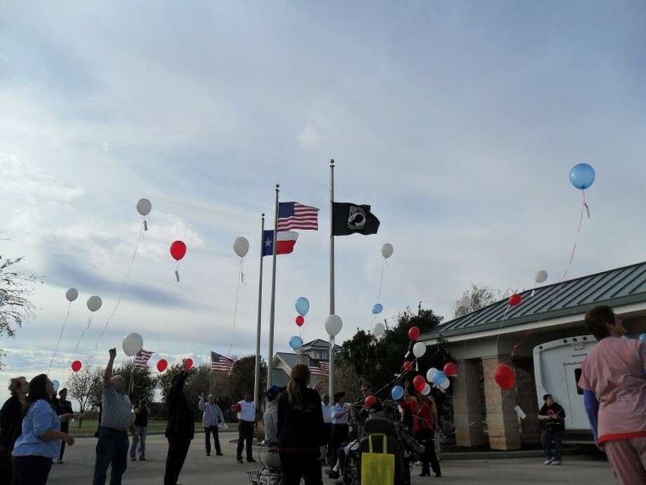Participants release balloons during a Veterans Day ceremony Friday at Lamun-Lusk-Sanchez Texas State Veterans Home in Big Spring. Photo:  Audrie Palmer/Reporter-Telegram