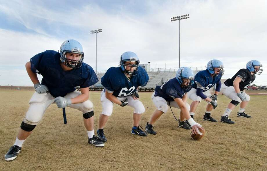 Greenwood offensive lineman Call Carmichael, from left, Sean Strickland, Blain Latham, Justin Moore and Jody Lively are preparing for Friday's Division 2-A playoff game against Pecos. Cindeka Nealy/Reporter-Telegram Photo: Cindeka Nealy
