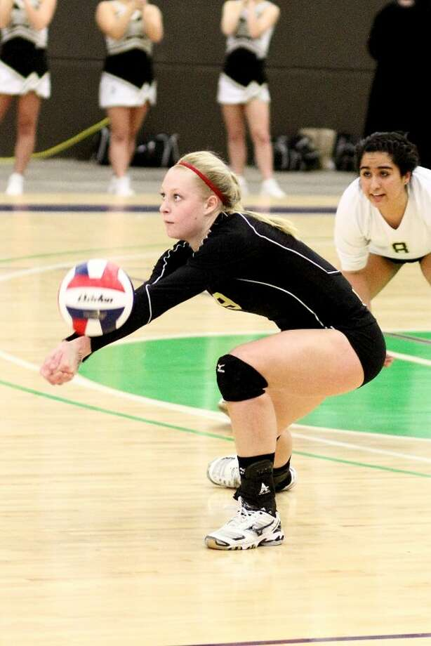 Andrews Lady Mustang, Callie Ives, passes the ball to a teammate during Andrews' 3-1 victory over Big Spring's Lady Steers in the Semi-Final round of the Region 1 Class 3A volleyball tournament on Friday, November 11, 2011. Photo: Tony Claxton