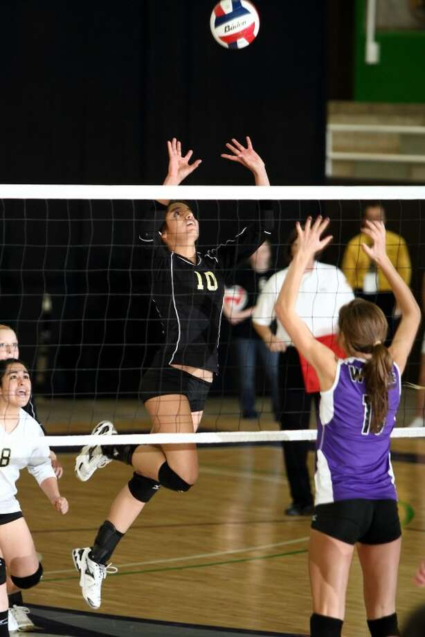 Andrews Lady Mustang Rayna Diaz goes up to hit the ball over the net during the Lady's final round match in the Region 1 Class 3A regional tournament which was played on Saturday, November 12, 2011. Andrews lost the match to Abilene Wylie 3-1. Photo: Tony Claxton